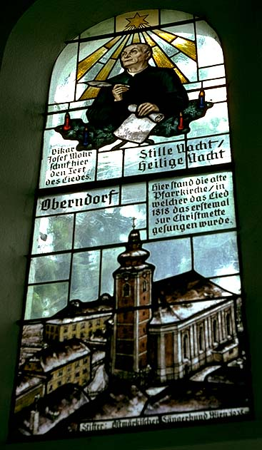 "The Josef Mohr window in the Silent Night Chapel (Stille-Nacht-Kapelle) in Oberndorf bei Salzburg, Austria. The stained-glass window depicts Josef Mohr, the author of the lyrics for ""Silent Night,"" with a brief history of the chapel and the church that originally stood there."