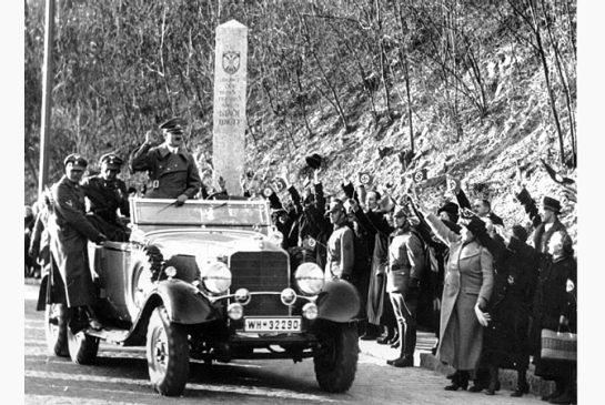 Adolf Hitler enters the city limits of Vienna on March 14, 1938, two days after German Werhmacht troops entered the country during the 'Anschluss.'