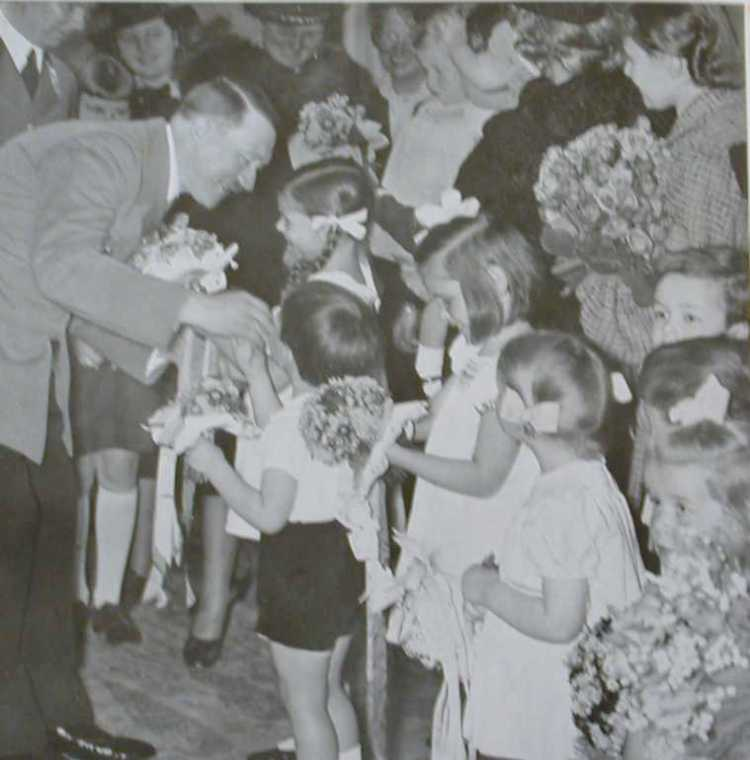 The caption here: 'Cheerfully and joyfully, even the smallest children bring their floral bouquets and read their little poems.'