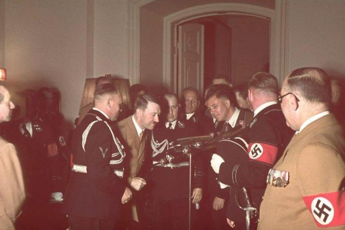 Adolf Hitler receives a model of a Condor airplane as a gift on his 50th birthday, Berlin, April 20, 1939. Beside Hitler (left) stands Capt. Hans Bauer, his personal pilot.