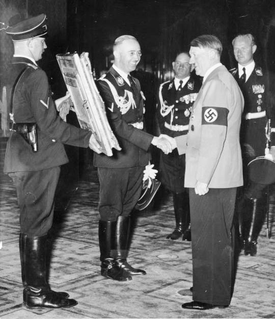 Reichsführer-SS Heinrich Himmler presents Hitler with a gift  in celebration of Adolf Hitler's 50th birthday, April 20, 1939.