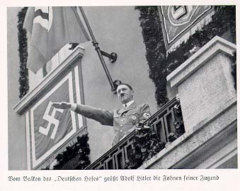 Hitler's standard hotel in Nuremberg was the Hotel Deutscher Hof. Here he greets members of the Hitler Youth.
