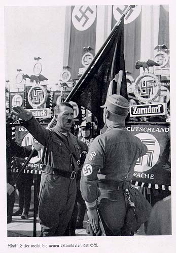 Hitler dedicates new S.A. banners.