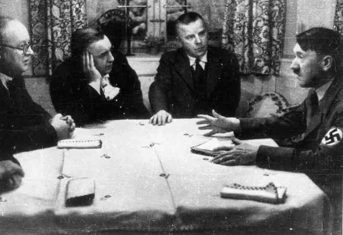 Meeting between Adolf Hitler, the party publishers Max Amann and Adolf Müller and the treasurer, Franz Xaver Schwarz (right to left) recorded in Amann's private home on the Tegernsee, in June 1935