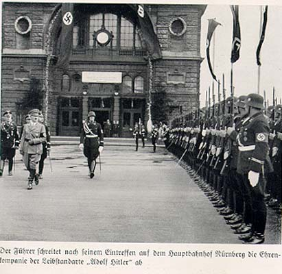 Hitler arrives in Nuremberg and is greeted by his personal guard, the Leibstandarte