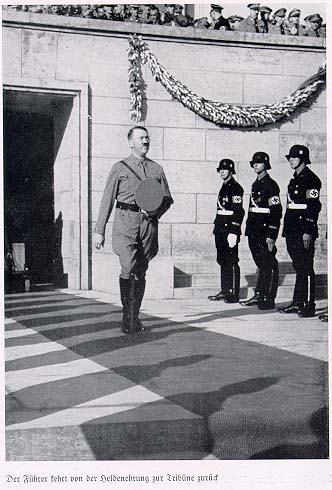 Hitler finishing an observance in honor of the dead.